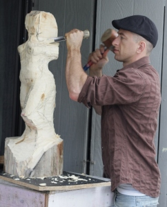 Rudolf-Sokolovski-in-studio-carving-white-cedar-wood-modern-sculpture-827x1024