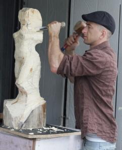 Rudolf-Sokolovski-in-studio-carving-white-cedar-wood-modern-sculpture-827x1024